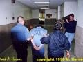 Suspect Linda Henning in handcuffs