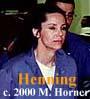 Defendant Linda Henning wearing blue prison uniform and white undershirt.